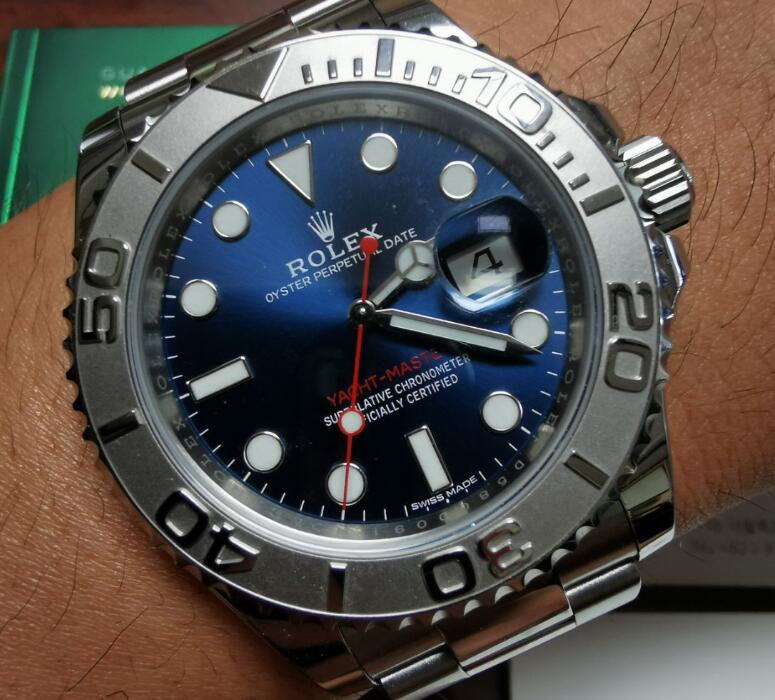 The red second hand is striking on the blue dial.