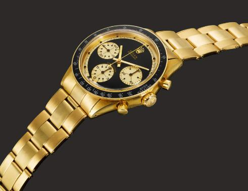 The gold sub-dials are contrasted to the black dial.