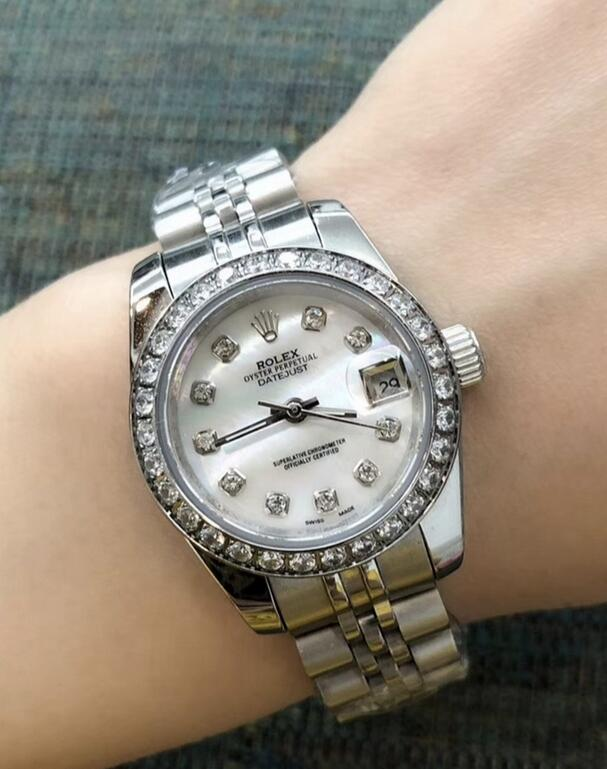 Self-winding fake watches are dazzling with diamond layout.